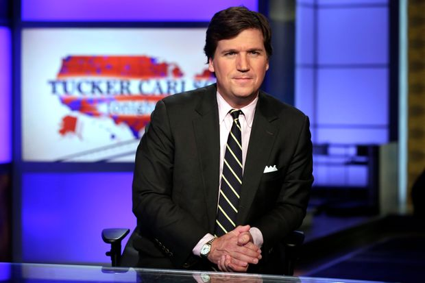 : Tucker Carlson lashes out at those who exposed writer's racist posts