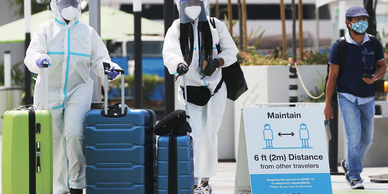 Coronavirus cases linked to long airline flights early in pandemic, studies show