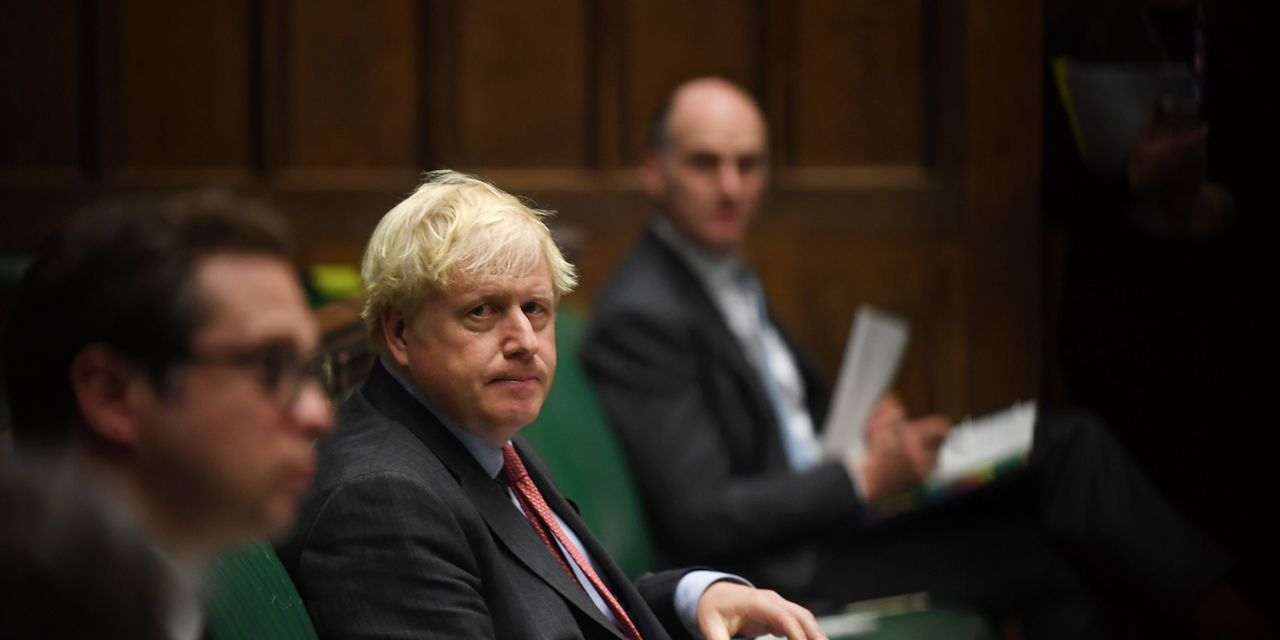 U.K. Prime Minister Boris Johnson unveils new coronavirus restrictions that could last six months — including pub and restaurant curfews