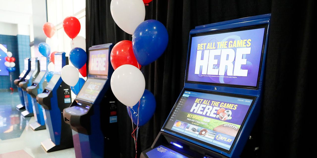 William Hill surges on deal talk as London...