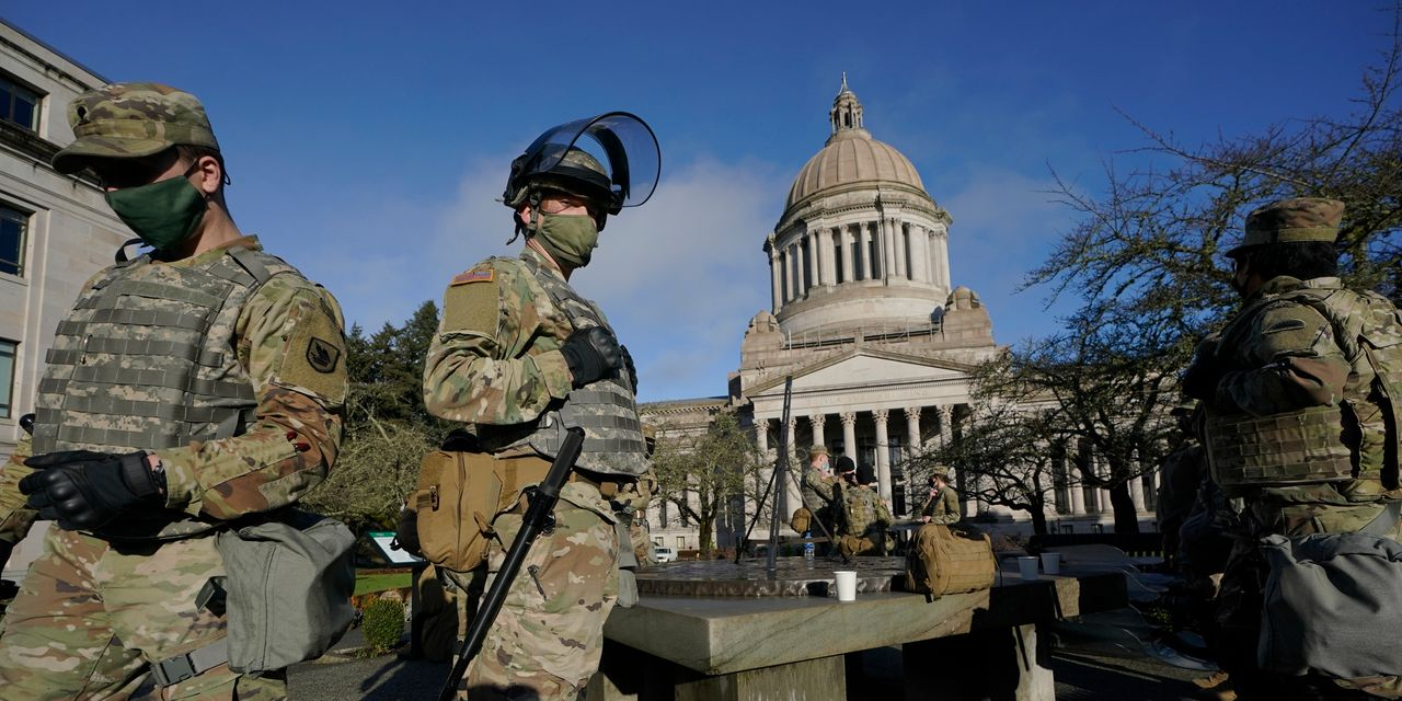 Small groups of right-wing protesters — some armed — gather at statehouses; no reports of clashes