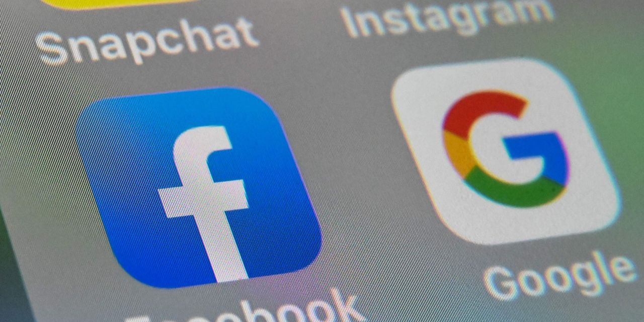 Australia passes law requiring Google, Facebook to pay for news