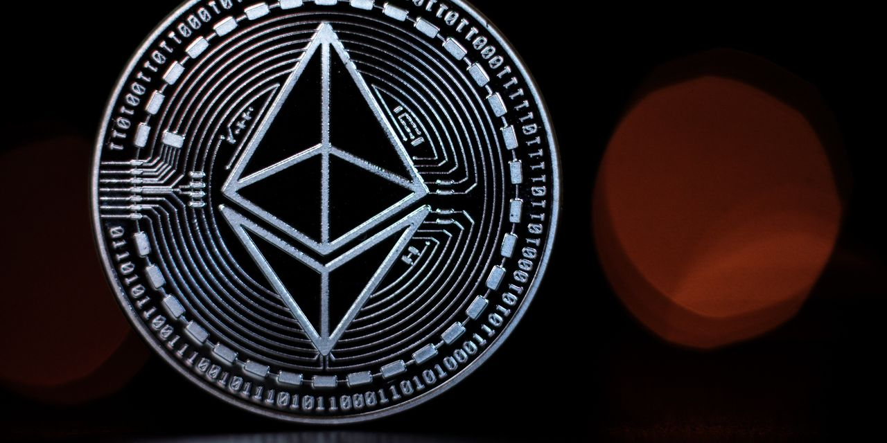 Ether, the No. 2 crypto, hit a record above $2,100 as bitcoin trades n... image