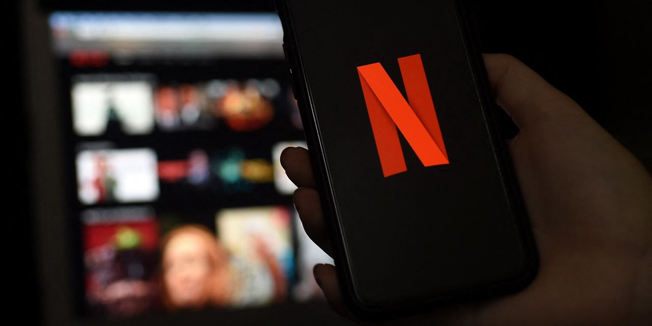 Dow finishes up over 300 points despite worries over COVID, Netflix earnings