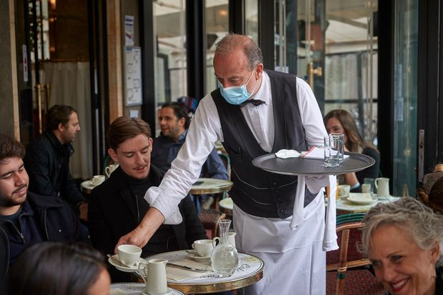 France's sidewalk cafes and restaurants reopen after 6-month shutdown -  MarketWatch