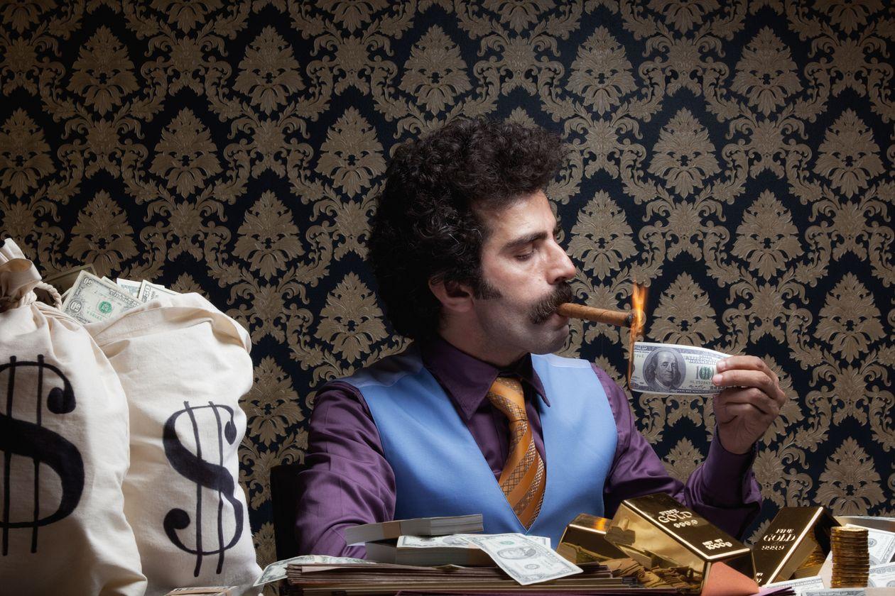 Rich man smoking in desk