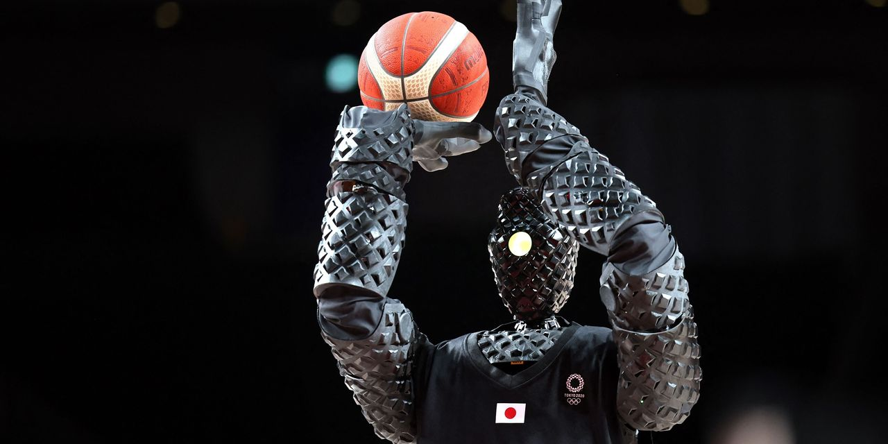 He shoots, he scares! Toyota's basketball robot steals the show at the Tokyo Olympics.