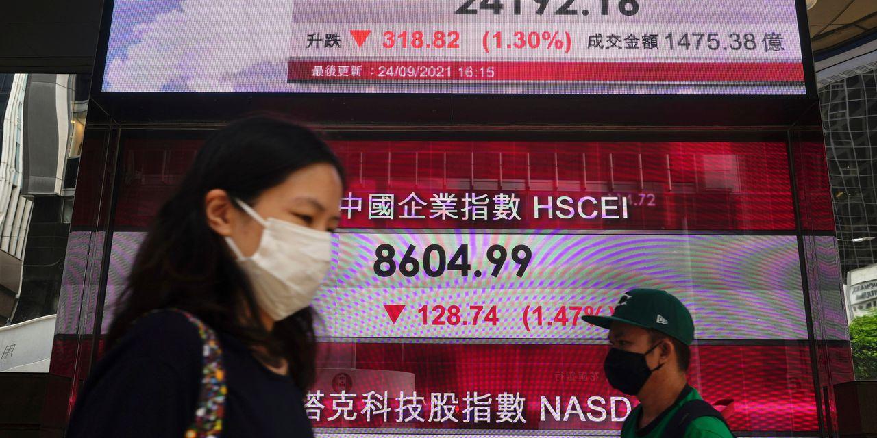Asian markets rise, but Shanghai slips as virus fears cloud outlook