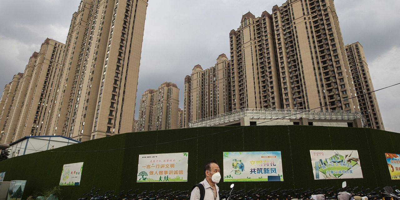 China Evergrande calls off deal to sell stake in property unit falls